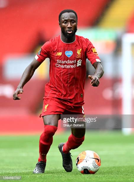 Naby Keita of Liverpool runs with the ball during the Premier League match between Liverpool FC and Aston Villa at Anfield on July 05, 2020 in...