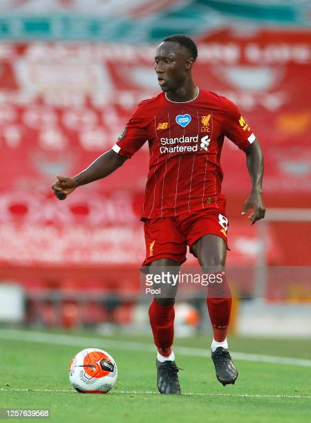 Naby Keita of Liverpool runs with the ball during the Premier League match between Liverpool FC and Chelsea FC at Anfield on July 22, 2020 in...