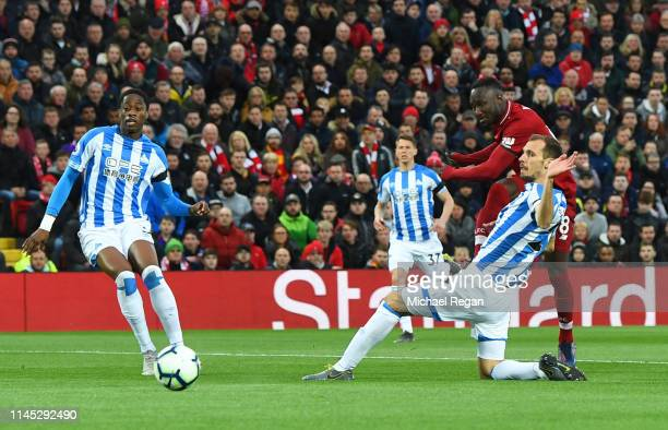 Naby Keita of Liverpool scores his team's first goal during the Premier League match between Liverpool FC and Huddersfield Town at Anfield on April...