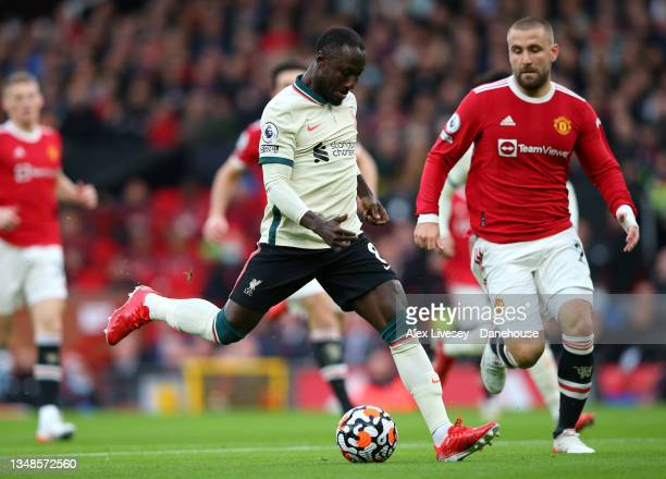 Naby Keita of Liverpool scores his teams first goal during the Premier League match between Manchester United and Liverpool at Old Trafford on...