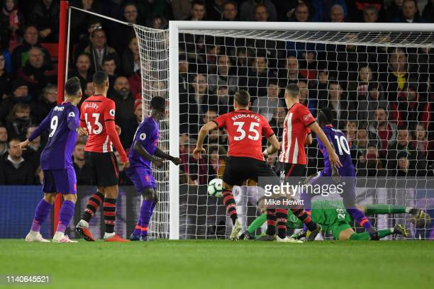 Naby Keita of Liverpool scores his team's first goal past Angus Gunn of Southampton during the Premier League match between Southampton FC and...