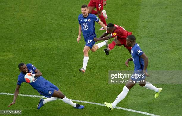 Naby Keita of Liverpool scores the opening goal during the Premier League match between Liverpool FC and Chelsea FC at Anfield on July 22, 2020 in...