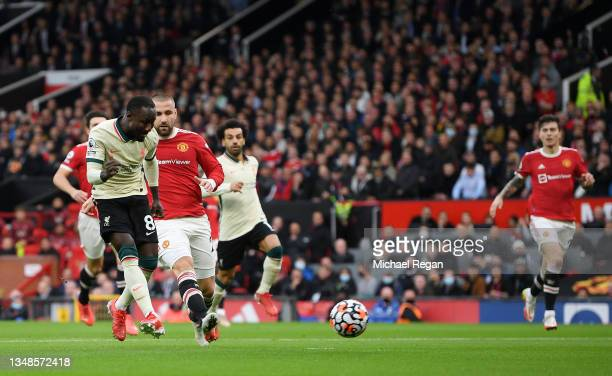 Naby Keita of Liverpool scores their sides first goal during the Premier League match between Manchester United and Liverpool at Old Trafford on...