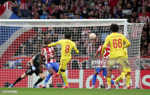Naby Keita of Liverpool scores their side's second goal during the UEFA Champions League group B match between Atletico Madrid and Liverpool FC at...