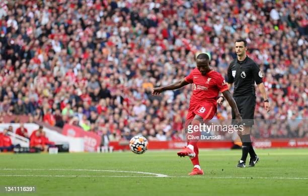 Naby Keita of Liverpool scores their team's third goal during the Premier League match between Liverpool and Crystal Palace at Anfield on September...