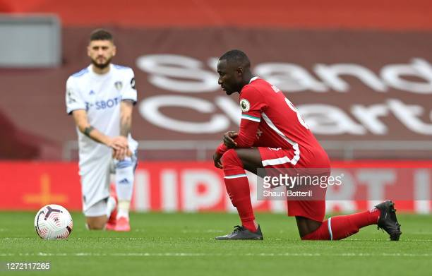 Naby Keita of Liverpool takes a knee in support of the Black Lives Matter movement prior to the Premier League match between Liverpool and Leeds...