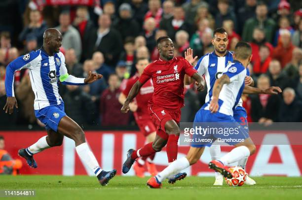 Naby Keita of Liverpool takes on Danilo and Jesus Corona of Porto during the UEFA Champions League Quarter Final first leg match between Liverpool...