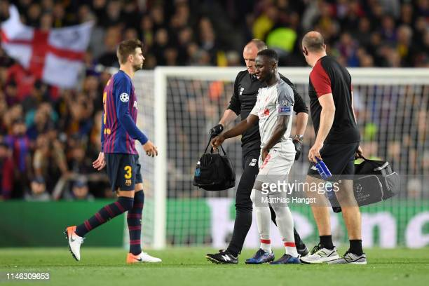 Naby Keita of Liverpool walks off the pitch after being injured during the UEFA Champions League Semi Final first leg match between Barcelona and...