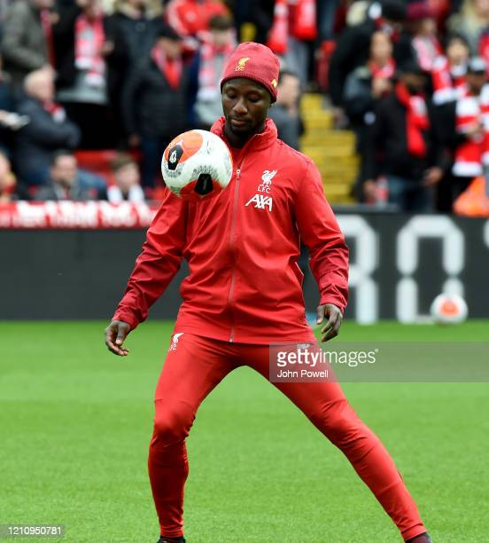 Naby Keita of Liverpool warms up before the Premier League match between Liverpool FC and AFC Bournemouth at Anfield on March 07 2020 in Liverpool...