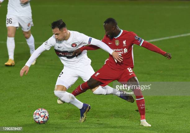 Naby Keita of Liverpool with Dion Cools during the UEFA Champions League Group D stage match between FC Midtjylland and Liverpool FC at MCH Arena on...