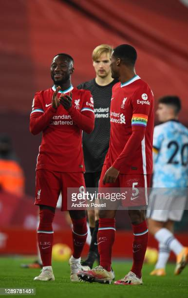 Naby Keita of Liverpool with Georginio Wijnaldum of Liverpool at the end of the Premier League match between Liverpool and Wolverhampton Wanderers at...