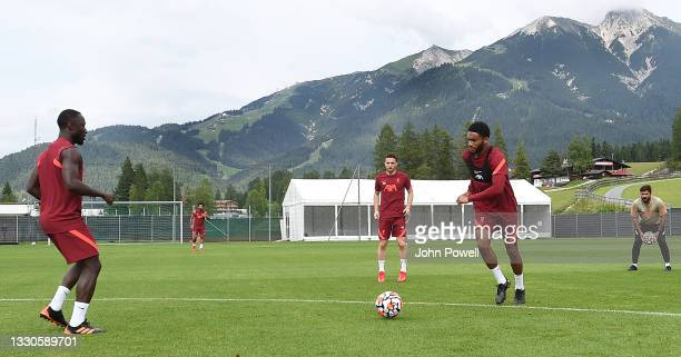 Naby Keita of Liverpool with Joe Gomez of Liverpool and Diogo Jota of Liverpool during a training session on July 25, 2021 in UNSPECIFIED, Austria.