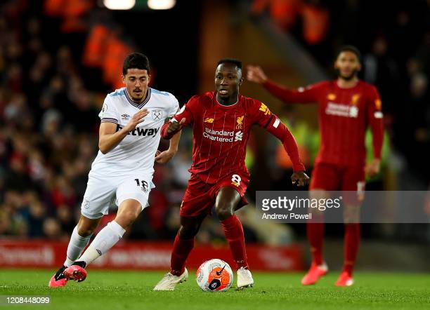 Naby Keita of Liverpool with Pablo Fornals of West Ham United during the Premier League match between Liverpool FC and West Ham United at Anfield on...