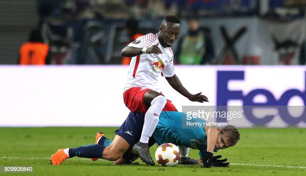 Naby Keita of RB Leipzig and Aleksandr Kokorin of FC Zenit Saint Petersburg compete during the UEFA Europa League Round of 16 match between RB...