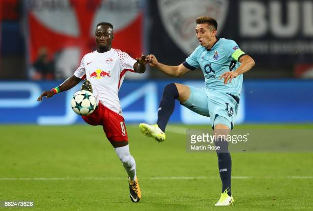 Naby Keita of RB Leipzig and Héctor Herrera of FC Porto battle for posession during the UEFA Champions League group G match between RB Leipzig and FC...