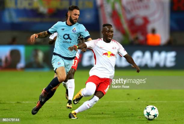 Naby Keita of RB Leipzig and Miguel Layún of FC Porto battle for posession during the UEFA Champions League group G match between RB Leipzig and FC...