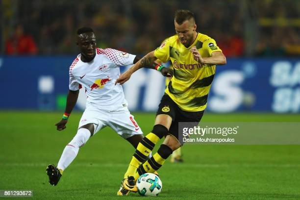 Naby Keita of RB Leipzig battles for the ball with Andriy Yarmolenko of Borussia Dortmund during the Bundesliga match between Borussia Dortmund and...