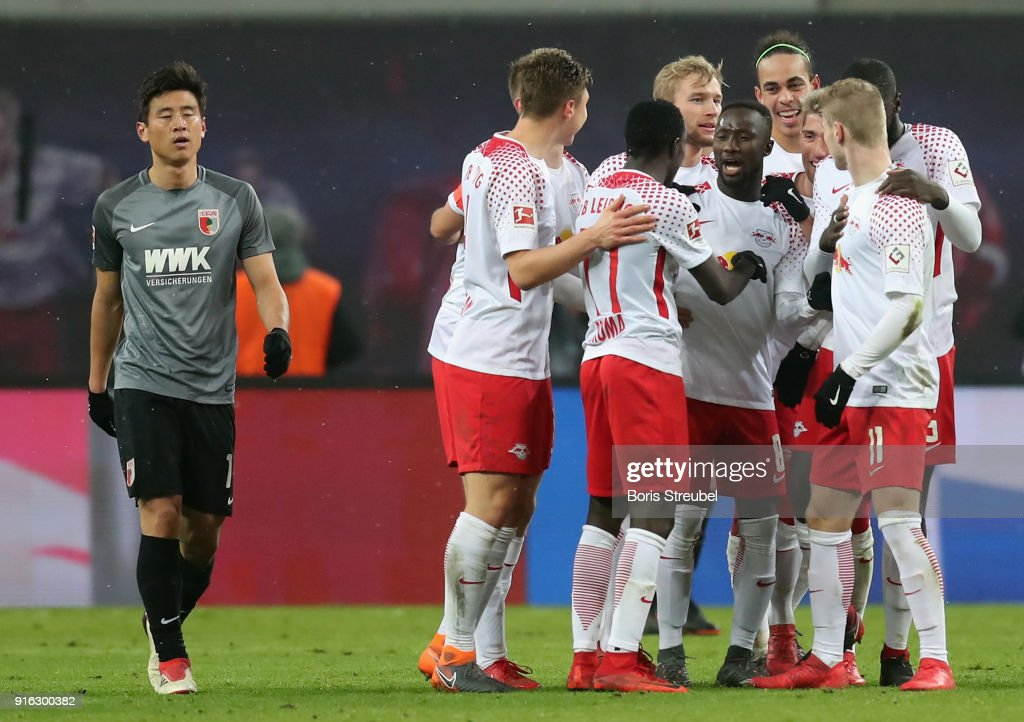 Naby Keita of RB Leipzig celebrates with team mates after scoring his team's second goal during the Bundesliga match between RB Leipzig and FC Augsburg at Red Bull Arena on February 9, 2018 in Leipzig, Germany.