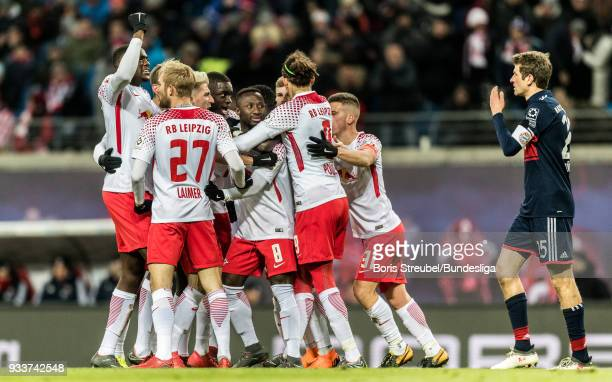 Naby Keita of RB Leipzig celebrates with team mates after scoring his team's first goal during the Bundesliga match between RB Leipzig and FC Bayern...