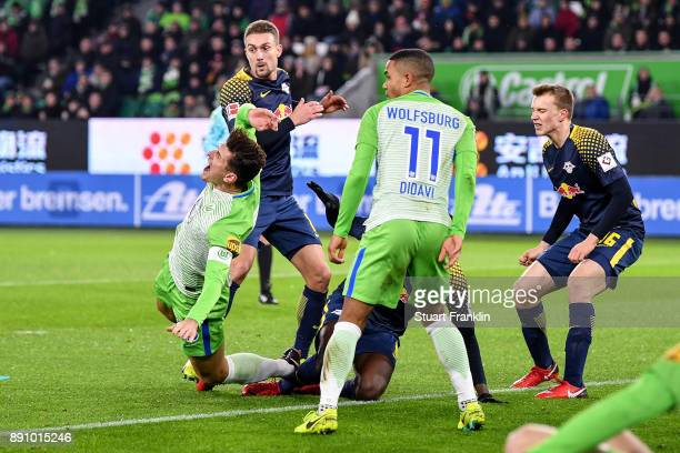 Naby Keita of RB Leipzig faults Mario Gomez of VfL Wolfsburg during the Bundesliga match between VfL Wolfsburg and RB Leipzig at Volkswagen Arena on...