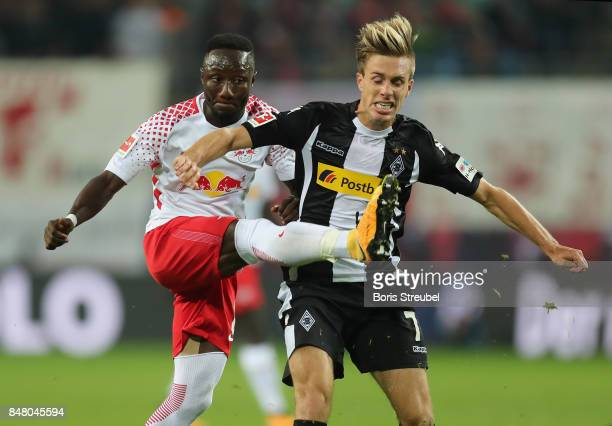 Naby Keita of RB Leipzig fights for the ball with Patrick Herrmann of Borussia Moenchengladbach during the Bundesliga match between RB Leipzig and...