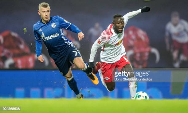 Naby Keita of RB Leipzig in action with Max Meyer of FC Schalke 04 during the Bundesliga match between RB Leipzig and FC Schalke 04 at Red Bull Arena...