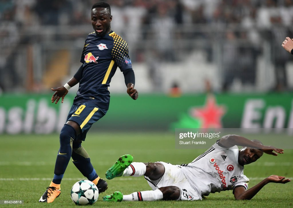 Naby Keita of RB Leipzig is tackled by Atiba Hutchinson of Besiktas during the UEFA Champions League Group G match between Besiktas and RB Leipzig at Besiktas Park on September 26, 2017 in Istanbul, Turkey.