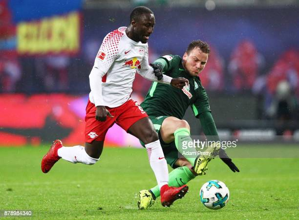 Naby Keita of RB Leipzig is tackled by Philipp Bargfrede of Werder Bremen during the Bundesliga match between RB Leipzig and SV Werder Bremen at Red...