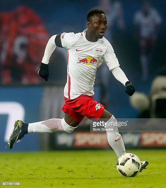 Naby Keita of RB Leipzig runs with the ball during the Bundesliga match between RB Leipzig and FC Schalke 04 at Red Bull Arena on December 3 2016 in...