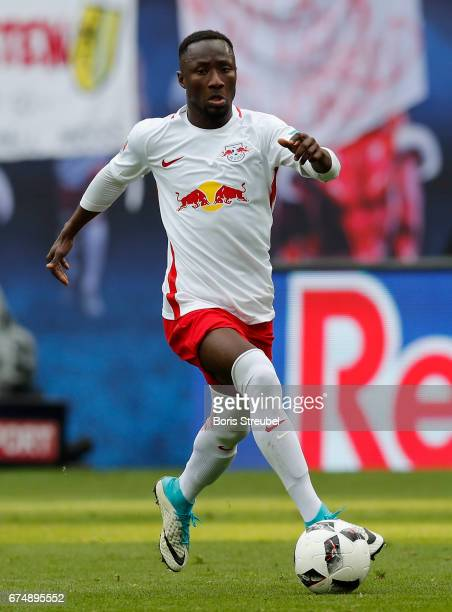 Naby Keita of RB Leipzig runs with the ball during the Bundesliga match between RB Leipzig and FC Ingolstadt 04 at Red Bull Arena on April 29 2017 in...