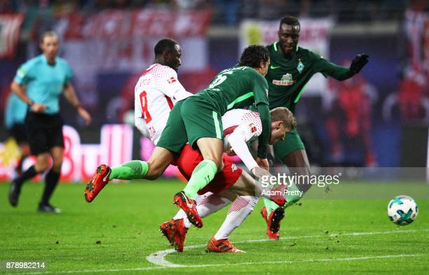 Naby Keita of RB Leipzig scores a goal behind Timo Werner of RB Leipzig who gives a pigy back ride to Thomas Delaney of Werder Bremen during the...