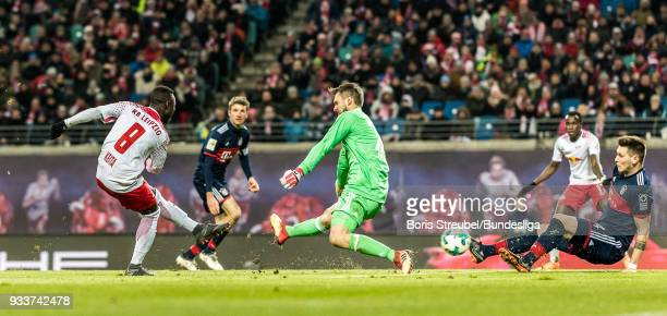 Naby Keita of RB Leipzig scores his team's first goal during the Bundesliga match between RB Leipzig and FC Bayern Muenchen at Red Bull Arena on...