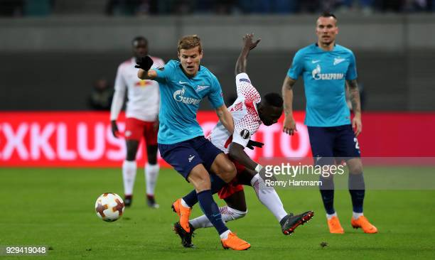 Naby Keita of RB Leipzig vies with Aleksandr Kokorin of FC Zenit Saint Petersburg during the UEFA Europa League Round of 16 match between RB Leipzig...
