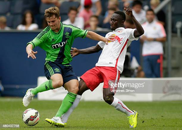 Naby Keita of Salzburg and Dominic Gape of Southampton fight for the ball during the preseason match for the 3rd place between FC Red Bull Salzburg...