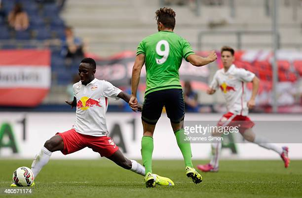 Naby Keita of Salzburg and Jay Rodriguez of Southampton fight for the ball during the preseason match for the 3rd place between FC Red Bull Salzburg...