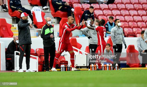 Naby Keita replaces Fabinho of Liverpool during the Premier League match between Liverpool and Leeds United at Anfield on September 12, 2020 in...