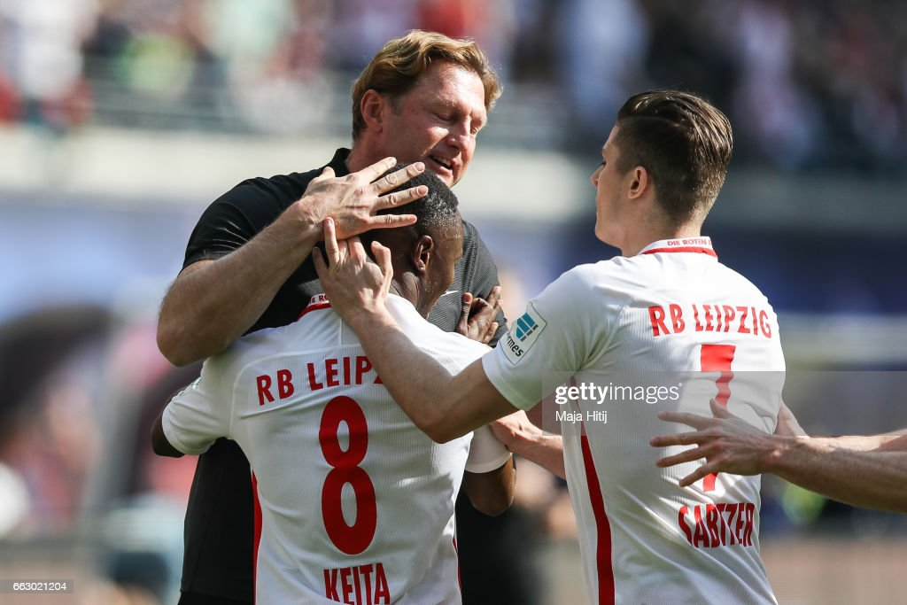 Naby Keitab (L) of Leipzig celebrates with head coach Ralph Hasenhuettl (C) and Marcel Sabitzer after scoring a goal to make it 1-0 the Bundesliga match between RB Leipzig and SV Darmstadt 98 at Red Bull Arena on April 1, 2017 in Leipzig, Germany.