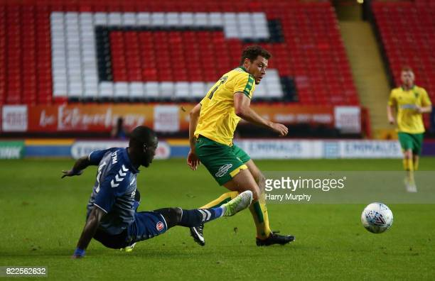 Naby Sarr of Charlton Athletic and Yanic Wildschut of Norwich City battle for possession during the Pre Season Friendly match between Charlton...