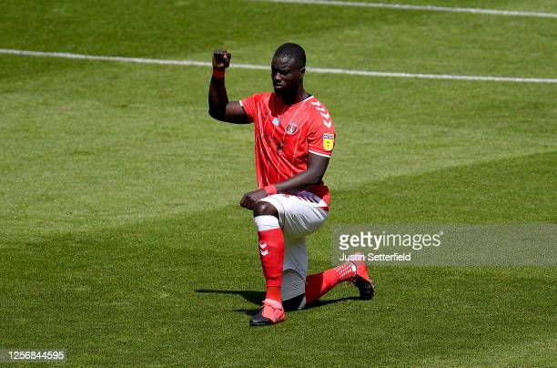 Naby Sarr of Charlton Athletic takes a knee in support of the Black Lives Matter movement during the Sky Bet Championship match between Charlton...