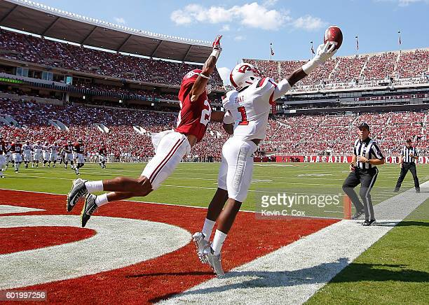 Nacarius Fant of the Western Kentucky Hilltoppers fails to pull in this touchdown reception against Anthony Averett of the Alabama Crimson Tide at...