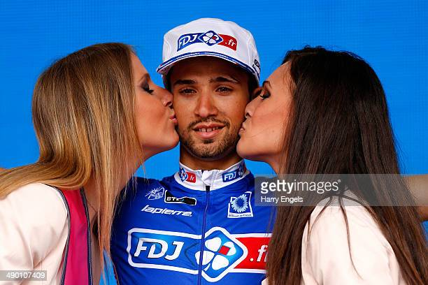 Nacer Bouhanni of France and FDJ.fr celebrates on the podium after winning the fourth stage of the 2014 Giro d'Italia, a 112km stage between...