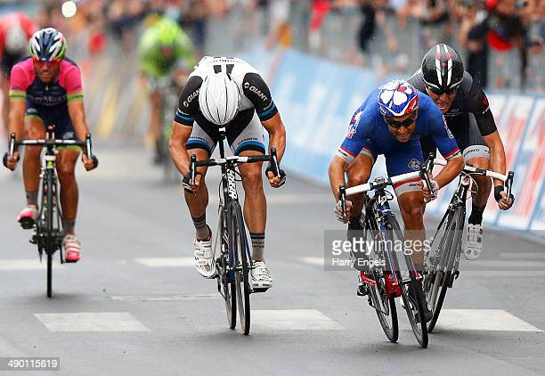 Nacer Bouhanni of France and team FDJ.fr beats Giacomo Nizzolo of Italy and team Trek Factory Racing and Tom Veelers of the Netherlands and team...