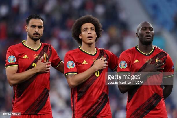 Nacer Chadli, Axel Witsel, and Romelu Lukaku of Belgium sing the national anthem prior to the UEFA Euro 2020 Championship Group B match between...