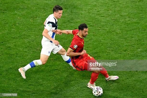 Nacer Chadli midfielder of Belgium is challenged by Jukka Raitala defender of Finland during the 16th UEFA Euro 2020 Championship Group B match...