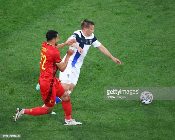 Nacer Chadli of Belgium and Robin Lod of Finland are seen in action during the European championship EURO 2020 between Belgium and Finland at Gazprom...
