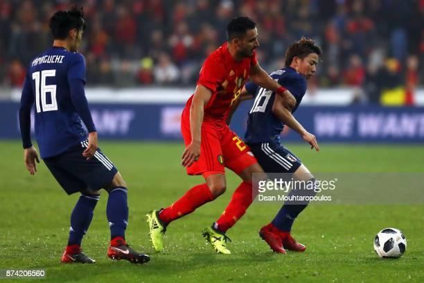 Nacer Chadli of Belgium battles for the ball with Takuma Asano and Hotaru Yamaguchi of Japan during the international friendly match between Belgium...