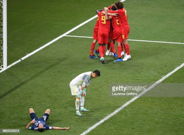Nacer Chadli of Belgium celebrates after scoring his team's third goal with team mates during the 2018 FIFA World Cup Russia Round of 16 match...