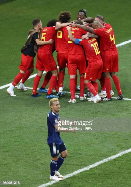 Nacer Chadli of Belgium celebrates with teammates after scoring his team's third goal during the 2018 FIFA World Cup Russia Round of 16 match between...