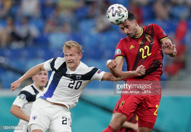 Nacer Chadli of Belgium competes for a header with Joel Pohjanpalo of Finland during the UEFA Euro 2020 Championship Group B match between Finland...