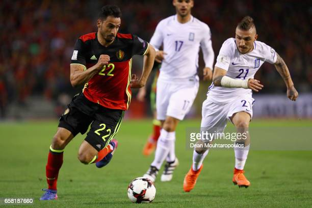 Nacer Chadli of Belgium gets past the tackle from Kostas Stafylidis of Greece during the FIFA 2018 World Cup Group H Qualifier match between Belgium...
